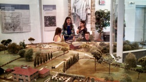 The kids, looking over a scale model of the original grounds.